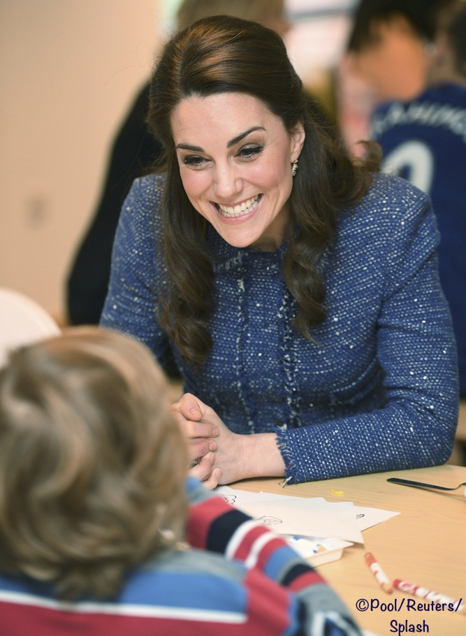 Britain's Catherine the Duchess of Cambridge speaks to a child at the Ronald Mc Donald House, the accommodation for families of children being treated at Evelina's children's hospital in London