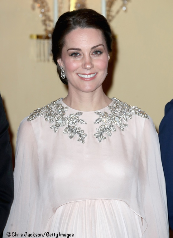 2931a5e5c3cb The Duchess was in a blush pink gown by Alexander McQueen. It looked like  it was made from a lightweight silk, with a round neckline, sleeveless  bodice, ...