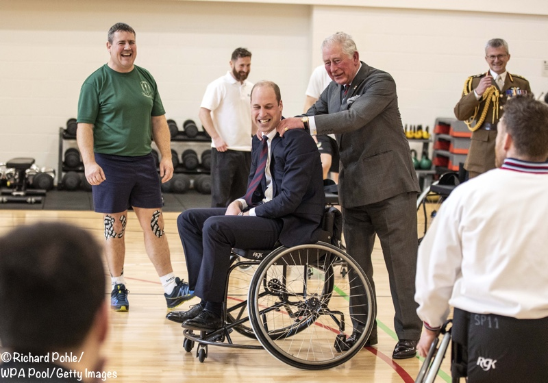 Prince Charles rubbing Prince William's Shoulders Basketball Defence Rehab